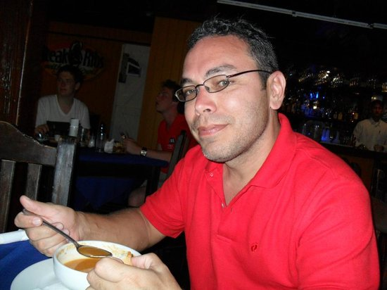 Steak & Ribs: Enjoying his seafood cream!