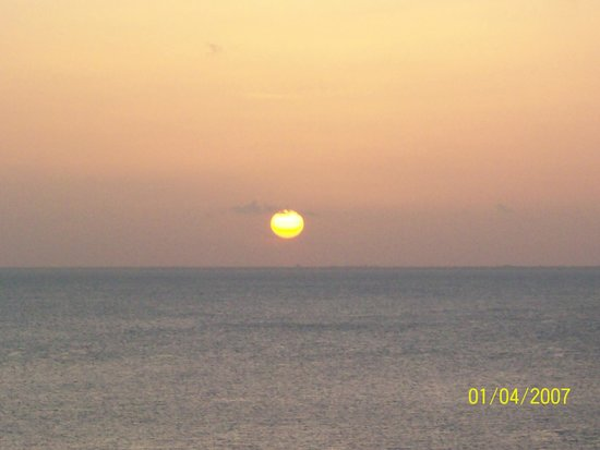Cozumel Palace : View of the sunset from our room balcony