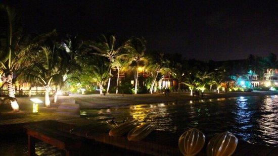 Ramon's Village Resort : Ramon's Village lights up the beach at night.