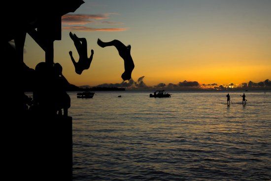Hanalei Pier : Kids jumping off the pier at Sunset.