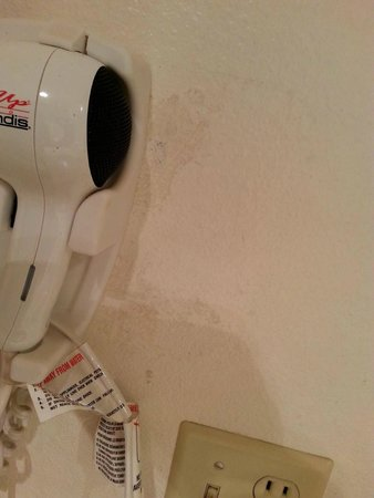 Motel 6 Clackamas: discolored pain by hair dryer