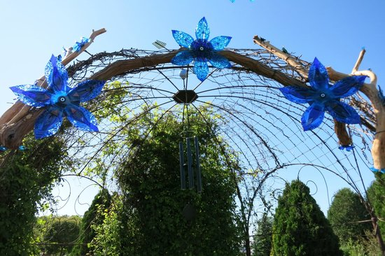 The Garden Door: Clematis tunnel with glass sculptures
