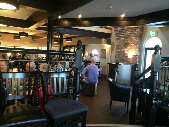 Downstairs in the Tides on a very busy night I know it is busy but it is taking too long to tak