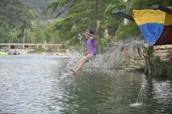 Neal's Lodges : Emily, age 10, takes a plunge into the Frio river