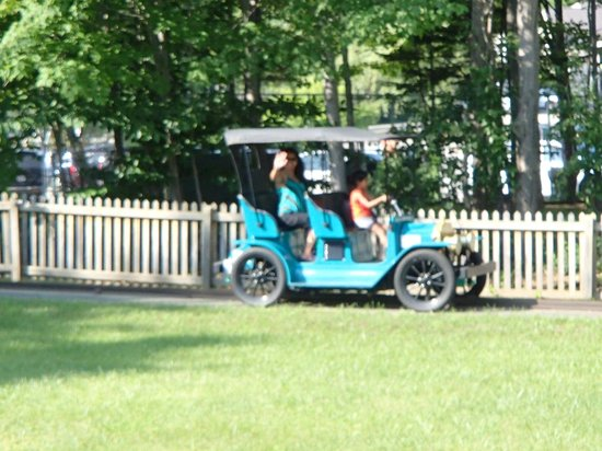 Story Land: Kids driving and parent in the back