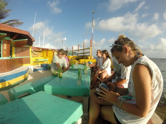 Isle of Reefs Tours - Day Tours: Enjoy a drink on a man made island