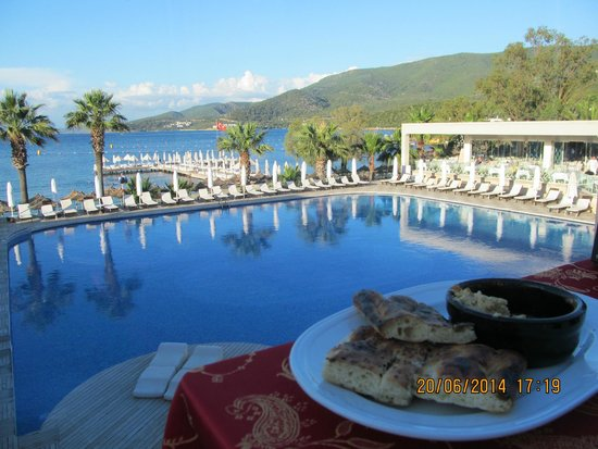 Voyage Torba: View of pontoon & pool from Kebabistan Restaurant