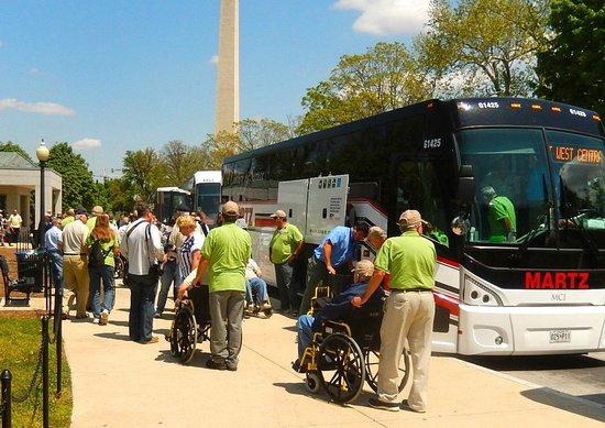 National World War II Memorial: WW II Veterans getting off 3 busses to visit their memorial