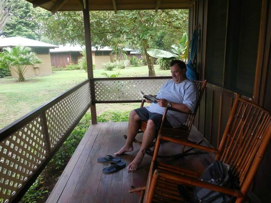 Mawamba Lodge : My cousin, Mike sitting on our porch at the Lodge.