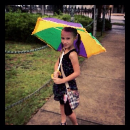 Mobile Carnival Museum: Outside with her new umbrella from the gift shop.