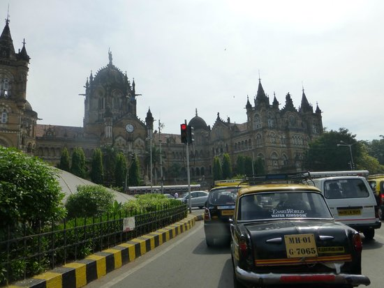 Chhatrapati Shivaji Terminus: Victoria Station shot from taxi