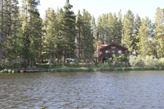 Moose Lake Lodge, LLC : View of cabin and dock, taken from paddleboat