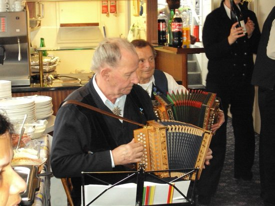 Cheese Factory at Engelberg : Jaloo Maneck enjoying the Orchestra Music on the Cruise Boat at Lake Lucern.