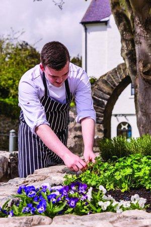 Ballygally Castle: Chef in herb garden