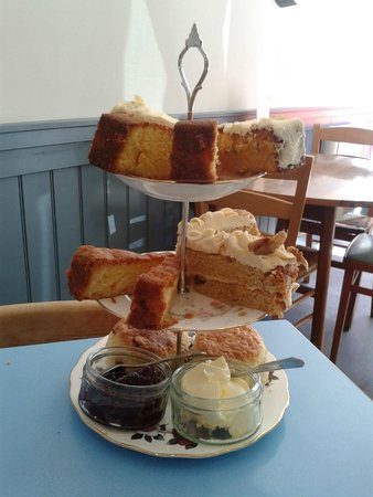 Elsie Harrhy Coffee House: Cake stands with scones and four cakes: lemon, apple, carrot and almond, and walnut and coffee