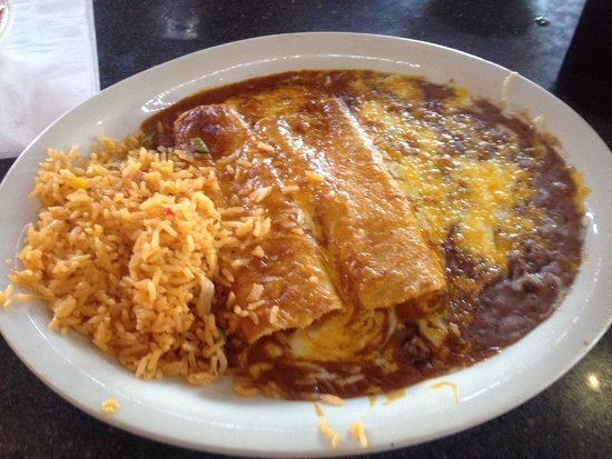 Sergio's Mexican Restaurant: 2 Cheese enchiladas with rice in beans. Very tasty. & Hot!! Enjoy!