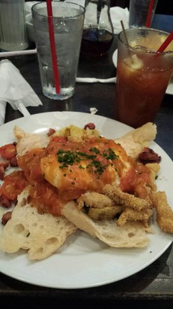 The Ruby Slipper Cafe: Think this was the coubion. Fried catfish topped with a poach eggs and some type of sauce!