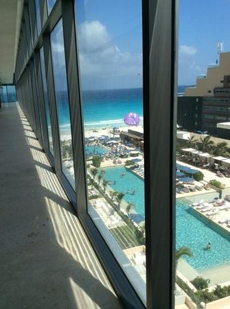 Secrets The Vine Cancún: view of 2 or 3 ground pools from 12th floor - spa / gym and PC pool level