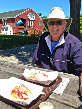 Shore Road Restaurant & Market: Our two large lobster rolls on the picnic table outside