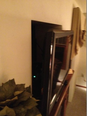 Bridgeport Resort : Hole in wall where new LCD is