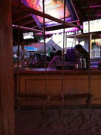 Mojito Bay Tiki Bar: Rope swing bar seats.