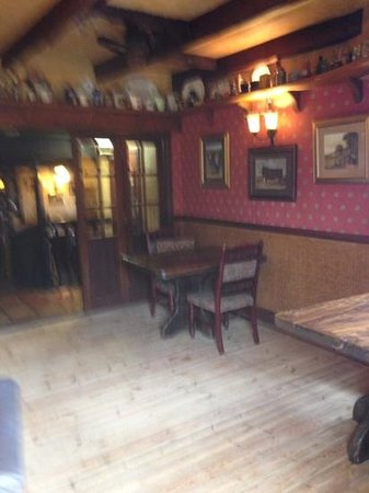 The Cook & Barker Inn: leading from outside area to bar area