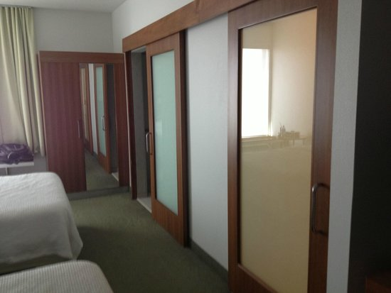 SpringHill Suites Houston Rosenberg : Hotel room with two bathrooms.