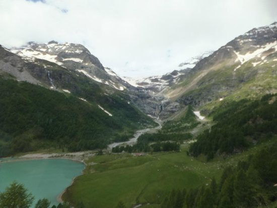 Bernina Express: view from the train of the mountain, glacier and lake below