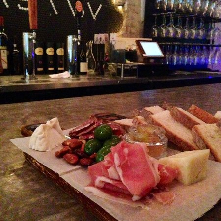 Paulie's Restaurant: Charcuterie board - 2 meats, 2 cheeses, bread, olives, jam