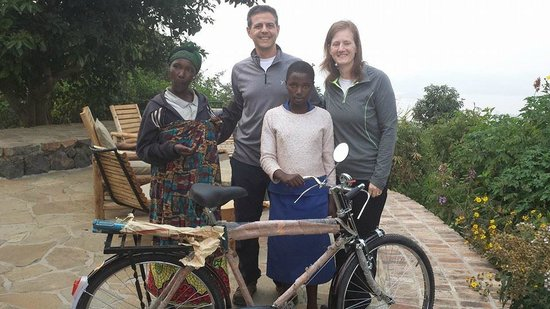 Virunga Lodge: Donating the Bicycle to a Top Student from Local School