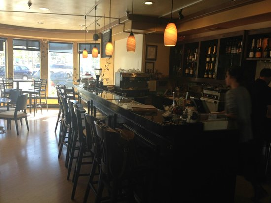 Cuvee Champagne Bar : These seats get filled quickly on these warm summer days!