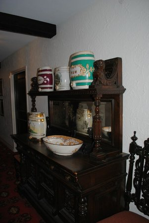 The Cheshire : antiques in the hallway