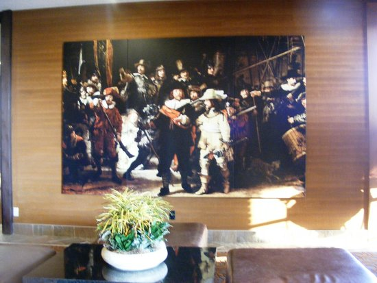 Mirabeau Park Hotel: A beautiful Mural in the Front Desk Area.  No waiting required
