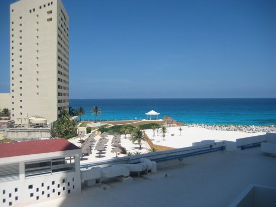 """Krystal Grand Punta Cancun: We did not have an """"ocean view"""" room but we could still see a bit of it peeking out"""
