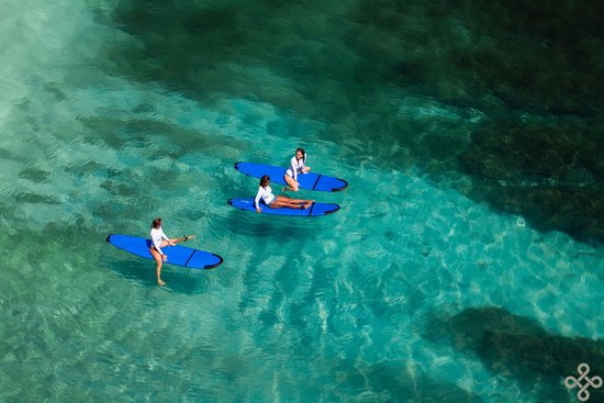 Escape Haven Bali: A beautiful shot of our girls relaxing in the ocean after SUP