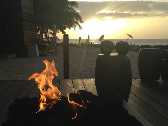 Sandals LaSource Grenada Resort and Spa: Sunset and Fire and Coconuts!