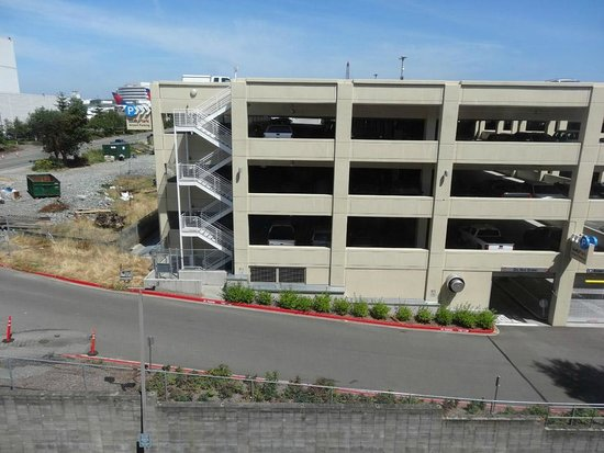 La Quinta Inn & Suites Seattle Sea-Tac Airport: View of parkade and planes (far left).