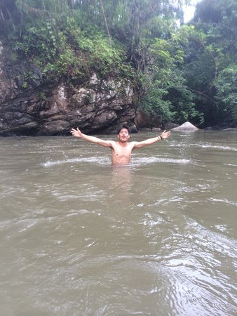 Something Different Tours: Our guide in the waterfall!