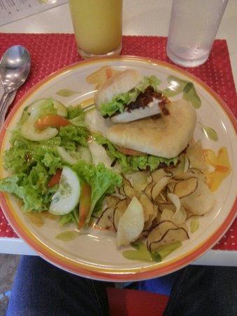 Edgy Veggy Vegetarian Cafe: A mushroom vegan burger, camote chips, salad
