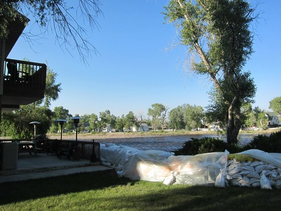 "Riviera Lodge: The ""Riviera"" view of sandbags and brushy river side"