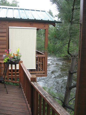 Paradise on the River: Looking to Creek View cabin. All have privacy screens on decks.