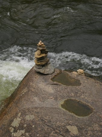 Paradise on the River: Kids built a cairn right below our deck on river.