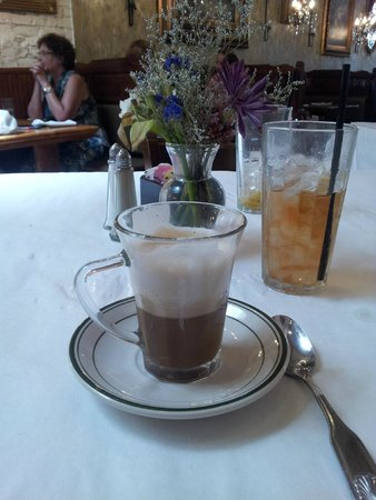 Tarrant's Cafe: A nice cappuccino served to math this elegant cafe