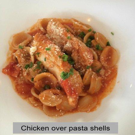 Captiva House: Mild red sauce, moderately breaded chicken over al dente pasta.