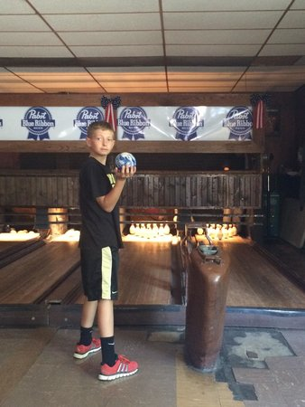 Koz's Mini Bowling: Bowling with a shorter lane and smaller ball.  It was great math practice for my 11 year old kee