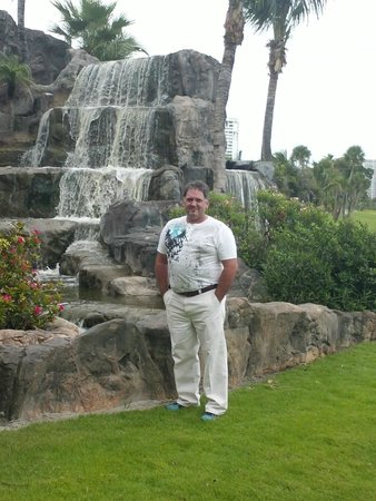 Turnberry Isle Miami, Autograph Collection: Posing for animal crackers at the falls on the rear of the property near the the greens.