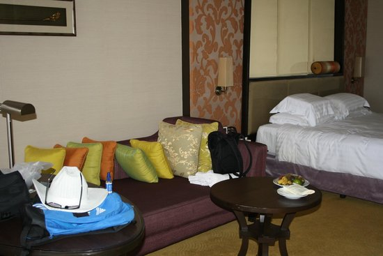 Dusit Thani Pattaya: Massive bed and couch (plus a desk behind it!)