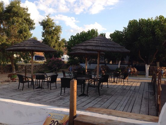 The chairs and tables of the Isalos hotel bar restaurant.