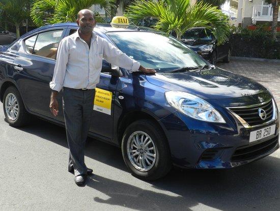 Pearle Beach Resort & Spa : Dev et son taxi