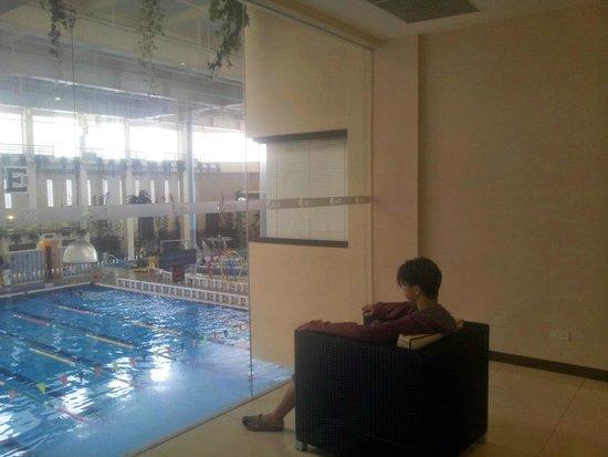 Ace Water Spa: My boyfriend pretends he's surveying his backyard pool. Humor him.